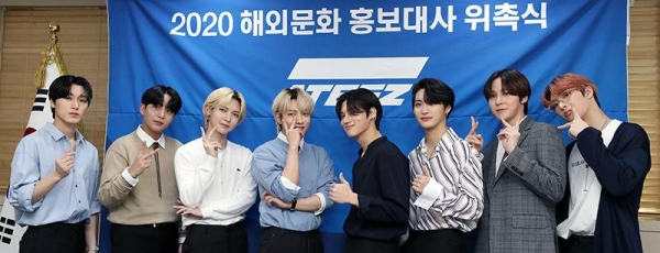 "The K-pop group ATEEZ on May 8 poses for a photo after being appointed promotional ambassador for the Korean Culture and Information Service, saying, ""We will hold the obligation and do our best to promote Korean culture abroad."" From left are Choi San, Choi Jongho, Kang Yeosang, Kim Hongjoong, Jung Wooyoung, Park Seonghwa, Jeong Yunho and Song Mingi."