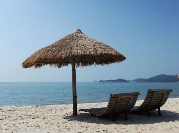 Parasols made from straw and bush clover align the white sands of Jjangttungeo (Mudskipper) Beach.